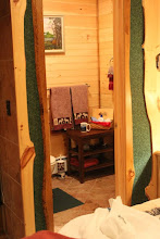 Photo: A separate bathroom accents this one bedroom cabin with jacuzzi bath and fireplace -  oh yes - and a cross section of colors in our distant sunset lake view.