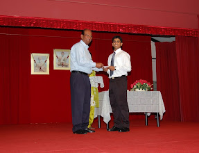 Photo: Arvind Rajagopalan receiving the Excellence Award. He is waiting for admission to a Medical school either in UK or Australia.