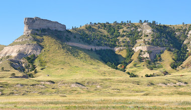 """Photo: In 1823 explorers rediscovered the route to the Rocky Mountains, and fur traders in the region relied on the bluffs as a landmark. European Americans named the most prominent bluff after Hiram Scott, a fur trader who died in 1828 near the bluff. The local Native Americans had called it Me-a-pa-te, """"the hill that is hard to go around."""""""