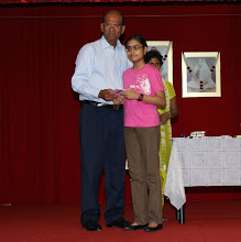 Photo: Saranya d/o Sivarama Subramaniam receiving the Excellence Award. She did well in PSLE.