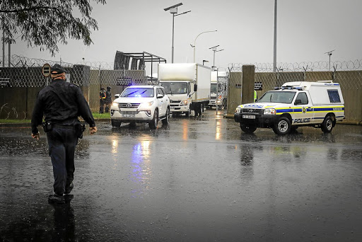 Two unmarked trucks accompanied by heavy security depart from OR Tambo Airport's cargo area this week with SA's first doses of the Covid vaccine.
