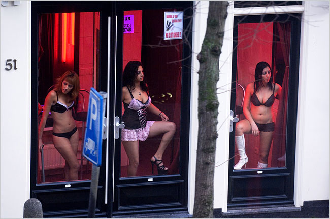 Women stand in the windows of the Red Light District. Photo: Herman Wouters for The International Herald Tribune.