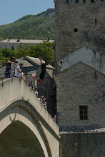 Photo: Young man going the heart-stopping dive from top of Mostar bridge (about 20m height)