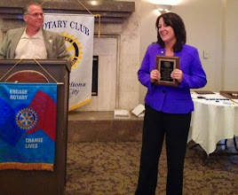 Photo: Mary Mula with the Lloyd Larsen Rotarian of the Year Award - June 20, 2014