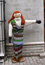 Photo: One of many life size doll pointing to shop entrances
