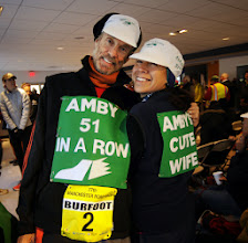 Photo: MANCHESTER 11/28/13  Amby Burfoot was in the press room before the race for was interviews. His wife Cristina (cq) made a series bibs for Amby's relatives to wear in the race. .(MRR Photo by John Long)