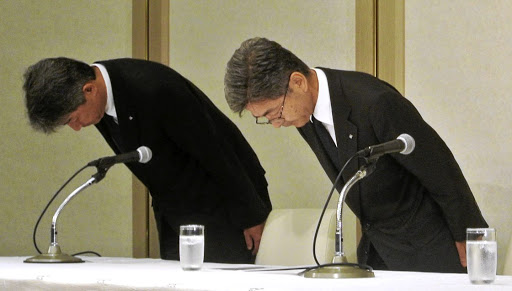 Kobe Steel executive vice-president Naoto Umehara, right, bows his head to apologise at a news conference in Tokyo on October 8 2017. Picture: KYODO VIA REUTERS