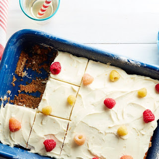 Vanilla-Buttermilk Sheet Cake with Raspberries and Orange Cream-Cheese Frosting.