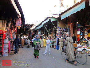 Photo: at the sides of the square are souks or traditional Marrakech markets