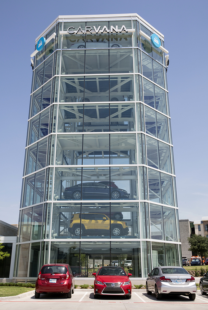 Vehicles sit parked outside the Carvana Co. car vending machine in Frisco, Texas, U.S