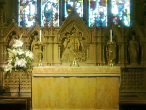 Photo: A wonderfully carved stone Altar area thrown into relief by lighting.