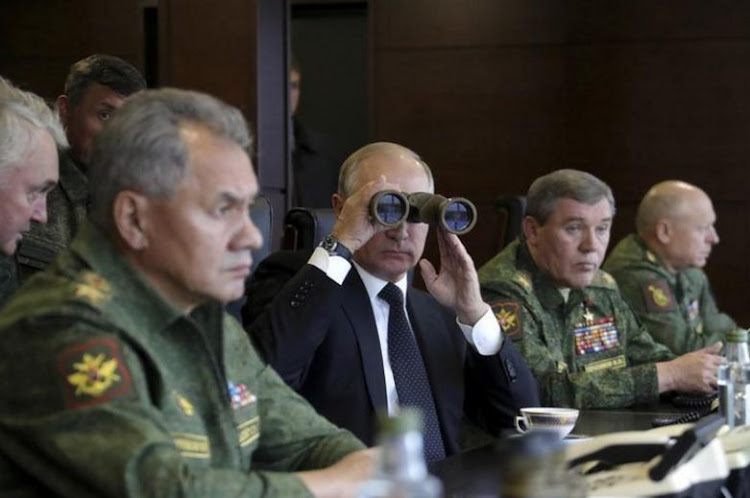 Russian President Vladimir Putin, flanked by senior Russian officials, watches the Zapad-2017 war games in the Leningrad region, Russia September 18, 2017. Picture: Sputnik/Mikhail Klimentyev/Kremlin via REUTERS