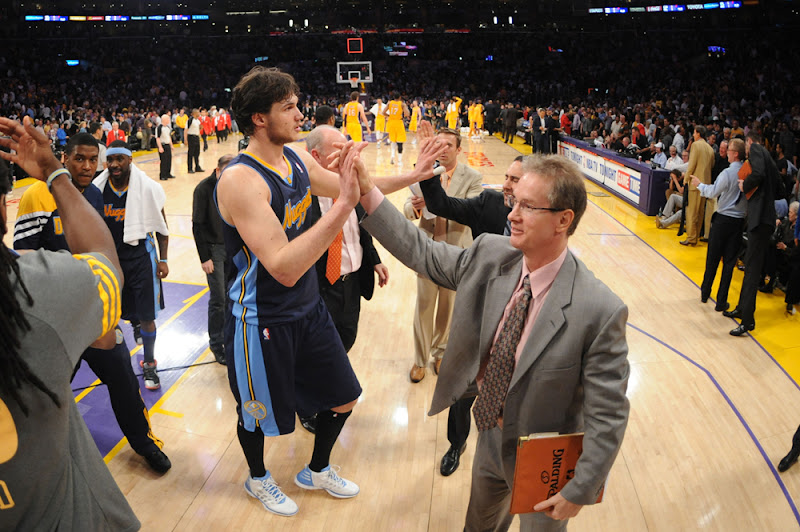 Photo: LOS ANGELES, CA - MAY 8:  Danilo Gallinari #8 of the Denver Nuggets slaps hands with coaches after helping his team defeat the Los Angeles Lakers in Game Five of the Western Conference Quarterfinals during the 2012 NBA Playoffs at Staples Center on May 8, 2012 in Los Angeles, California. NOTE TO USER: User expressly acknowledges and agrees that, by downloading and/or using this Photograph, user is consenting to the terms and conditions of the Getty Images License Agreement. Mandatory Copyright Notice: Copyright 2012 NBAE (Photo by Noah Graham/NBAE via Getty Images)