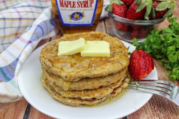 Whole Wheat Oatmeal Flaxseed Pancakes With Butter And Maple Syrup.
