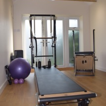 pilates studio with wooden floors