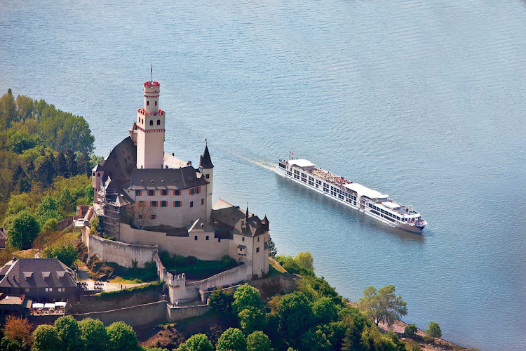 Uniworld's S.S. Antoinette passes a castle on the Rhine River.