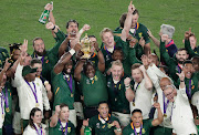 Siya Kolisi and South Africa president Cyril Ramaphosa celebrate with the Webb Ellis trophy after winning the World Cup Final.