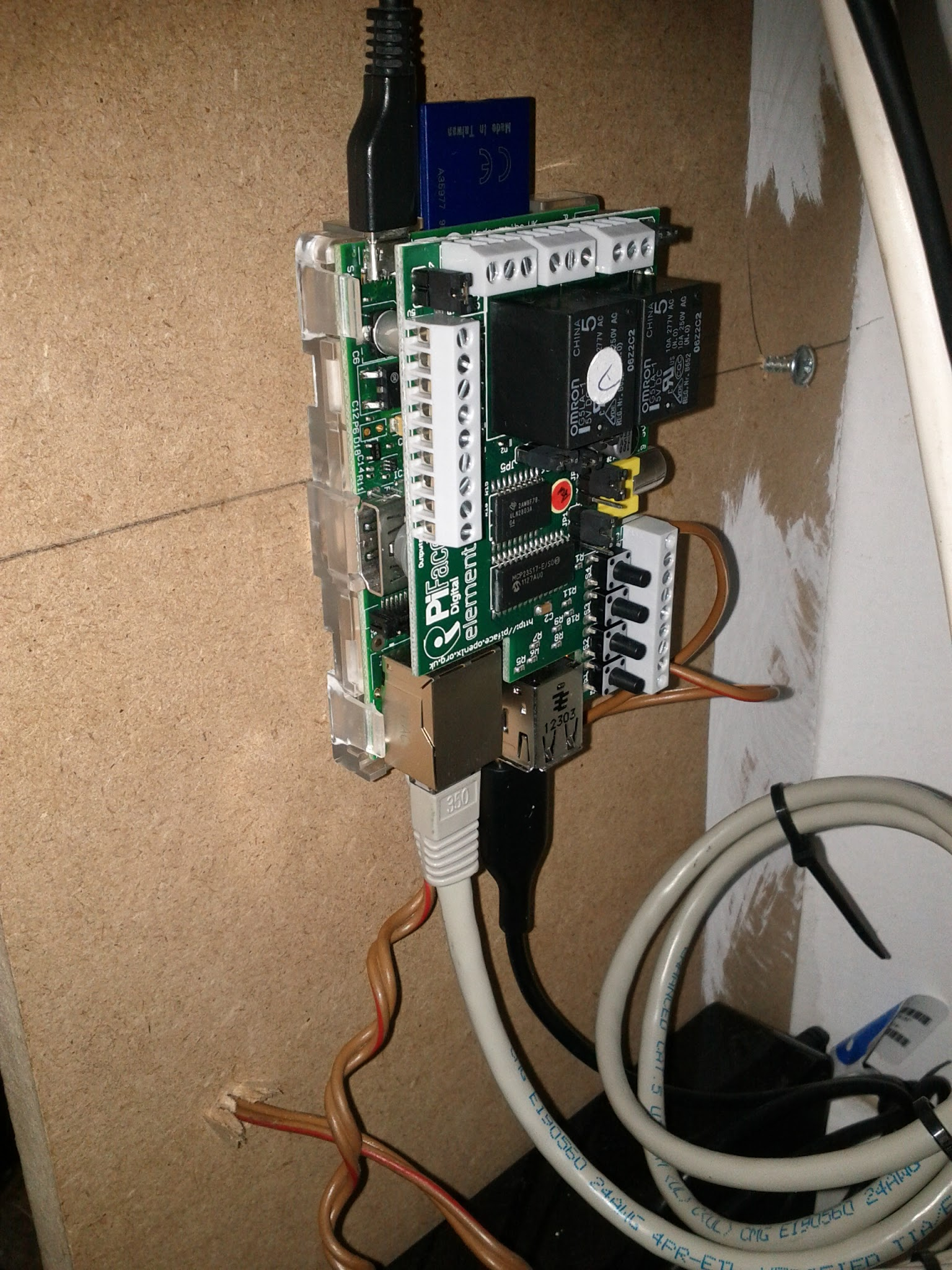 """Photo: The Raspberry Pi with a Piface reading the pulses from the gas meter or rather the reed switch. This is done with very simple Python code   #!/usr/bin/python from time import sleep from time import mktime from time import gmtime import datetime import piface.pfio as pfio pfio.init() lastread = 0 total = 0 while(True):   myread = pfio.digital_read(0)   if myread != lastread:      date = mktime(gmtime())      total = total + myread      print datetime.datetime.now().strftime(""""%Y-%m-%d %H:%M:%S""""),"""","""",date, """","""",myread,"""","""",total      lastread = myread   sleep(0.01)   The script gets fired off with nohup stdbuf -o0 ./read.py > test.out& to make sure it happily runs in the bachground. When you turn on the hot water you can then see the logfile showing each turn of the smallest wheel. The counts are pretty accurate, at least if you believe my daily readings."""