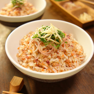 Cooked rice with added salmon flakes and dried pickled Japanese apricot paste