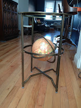 "Photo: $240. Glass & metal accent table with globe. 17"" round x 24"" high."