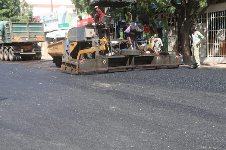 Workers busy re-carpeting a road in Garissa Town in June this year.