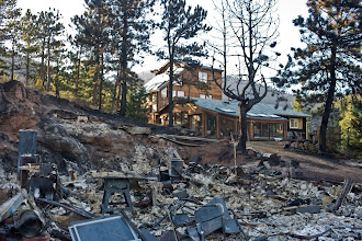 Photo: Houses inside of the Fourmile Canyon Fire near Boulder, Colorado in the wildland-urban interface.  The 7,000 acre fire claimed nearly 170 houses in the first days of the blaze.  Several of the houses that were saved had properly prepared their land for the potential of wildfire, including building with fire resistant materials as well as preparing defensible, fuel-minimized spaces in the areas surrouding the structure.