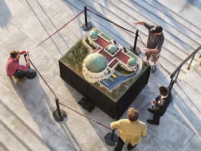 Photo: Visitors view a model of the observatory.