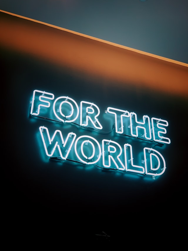 "Neon sign in capital letters reading ""FOR THE WORLD"" for Earth Hour"