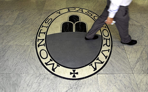 A man walks on a logo of the Monte Dei Paschi Di Siena bank in Rome, Italy. Picture: REUTERS