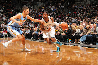 Photo: MarShon Brooks #9 of the Brooklyn Nets drives baseline against the Denver Nuggets at the Barclays Center on February 13, 2013 in Brooklyn, NY.