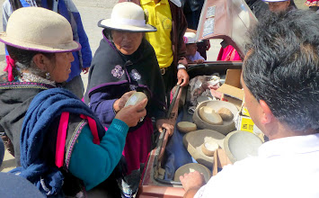Photo: Selling scooped-out river rocks from the trunk of a car