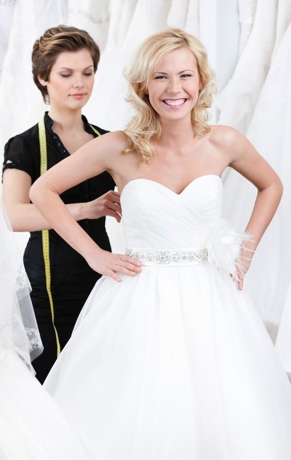 bridezilla-boot-camp-smiling-bride-fitting