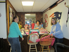 Photo: Tara, Cathy & Stephanie wrapping holiday gifts!