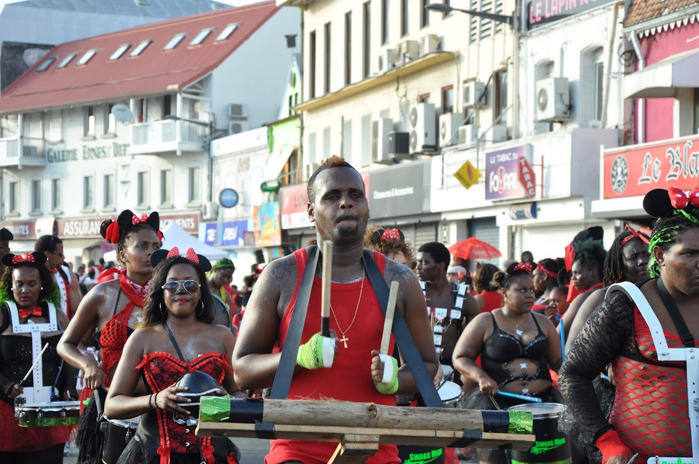 People wearing black and red according to the carnivals theme of the day
