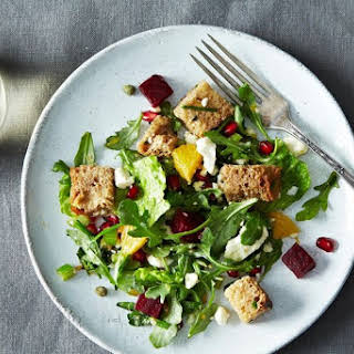Winter Panzanella with Orange, Roasted Beets, and Pomegranate Seeds.
