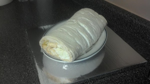 ROLLING: With the bottom sheet of wax paper, move the meringue toward you and fold...