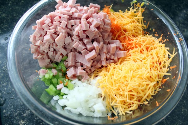 While they are boiling, chop or grate the Spam, celery, carrot, onion and cheese...