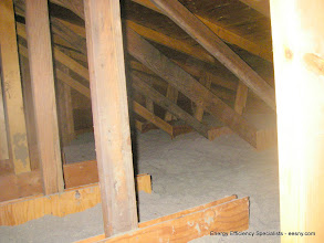 Photo: Very little insulation - 3 leaky can lights in attic.