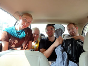 Photo: The four IGo students all cramped into the back seat of a small car. This was our primary transportation between the conference location and our hotel.
