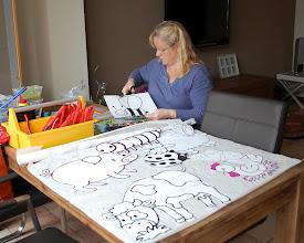 Photo: Monique bezig met de voorbereidingen