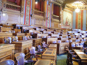 Photo: The Council Room, whose 163 members of the Paris Council (elected from the 20 arrondissements) elect the Mayor, who then presides over the Council. The wall tapestries were commissioned in 1865 for the Second Empire throne room.