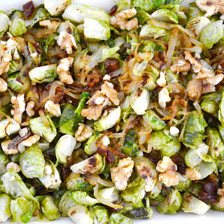 Roasted Brussels Sprouts With Walnuts, Dates, and Caramelized Onions [Vegan]