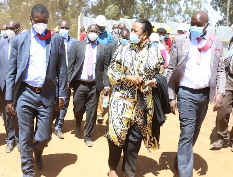 CS for sports Amina Mohamed and governor Jackson Mandago during an inspection of Kipchoge Stadium in Eldoret on January 16, Construction is to be completed by June