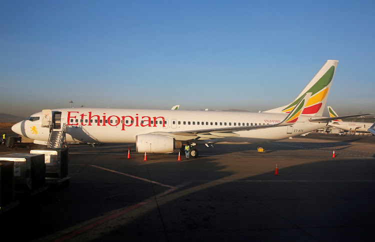 Workers service an Ethiopian Airlines Boeing 737-800 plane at the Bole International Airport in Ethiopia's capital Addis Ababa, on January 26 2017. All 149 passengers and eight crew members died when an Ethiopian Airlines Boeing 737 passenger jet to Nairobi crashed on Sunday.