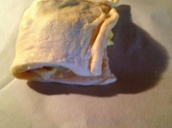 fold the dough in half pulling the dough over the egg & cheese