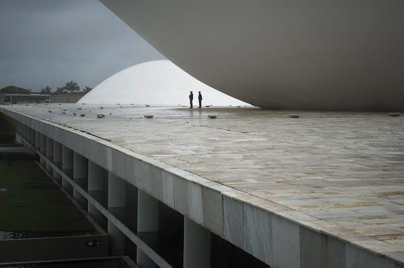 Photo: Two security guards stand on the roof of the National Congress building -- projected by world-renowned Brazilian architect Oscar Niemeyer --, on the eve of the inauguration of Brazil's first female leader, President-elect Dilma Rousseff, in Brasilia, on December 31, 2010. AFP PHOTO/Mauricio LIMA (Photo credit should read MAURICIO LIMA/AFP/Getty Images)