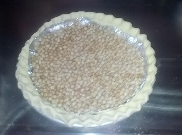 Take the pie crust out of your freezer, and cover the bottom and sides...