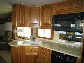 Photo: Solid Oak kitchen cabinets, propane stove, convection/microwave.