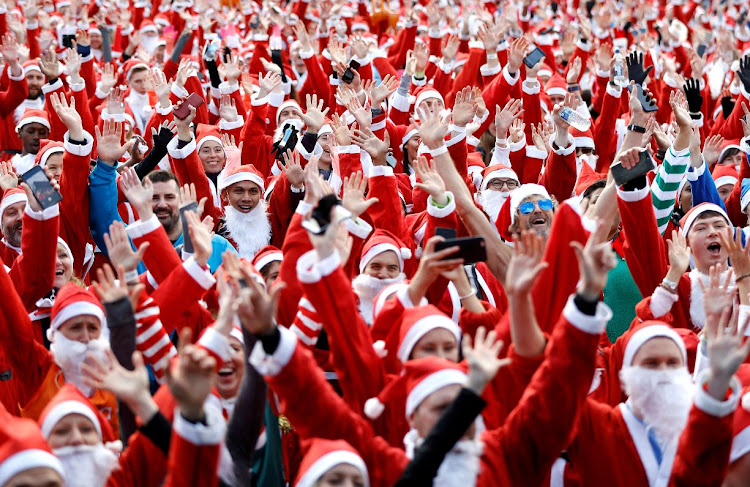 Competitors warm up ahead of the Santa Run in London.