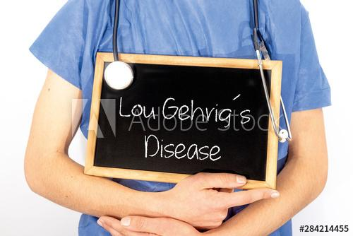 Doctor shows information on blackboard: lou gehrig´s disease.  Medical concept.